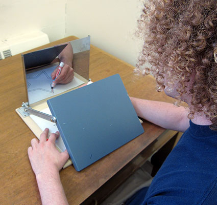 picture of someone tracing on paper with mirror